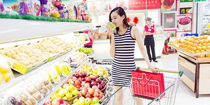 Chinese girl buying food at the supermarket
